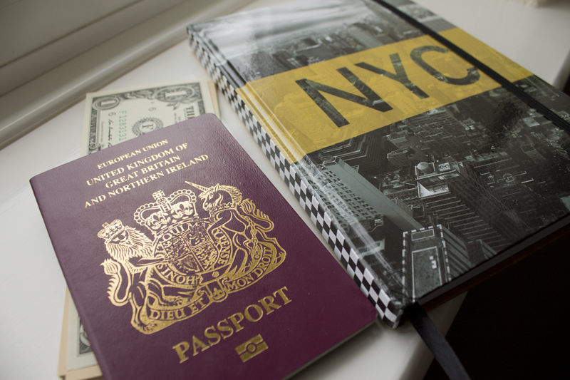 New York notebook, passport and dollars